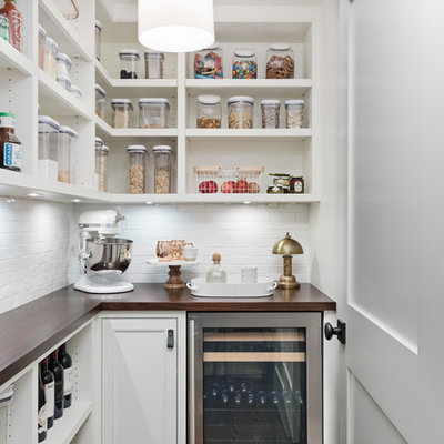 Transitional l-shaped dark wood floor and brown floor kitchen pantry photo in Detroit with open cabinets, white cabinets, wood countertops, white backsplash, stainless steel appliances and brown countertops