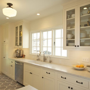 Small mediterranean enclosed kitchen appliance - Small tuscan galley ceramic tile enclosed kitchen photo in San Francisco with an undermount sink, shaker cabinets, white cabinets, quartz countertops, white backsplash, subway tile backsplash, stainless steel appliances and no island