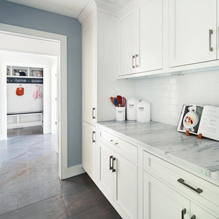 Mid-sized transitional kitchen pantry ideas - Example of a mid-sized transitional single-wall dark wood floor kitchen pantry design in New York with beaded inset cabinets, white cabinets, marble countertops, white backsplash, subway tile backsplash and an island