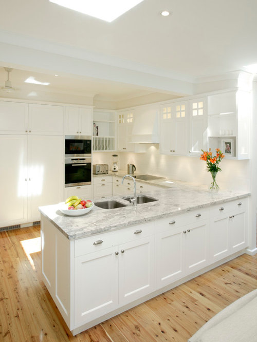 ... Traditional U-Shaped Eat-In Kitchen Design Ideas with Yellow Cabinets