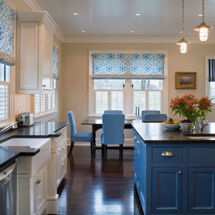 Elegant dark wood floor kitchen photo in Providence with a farmhouse sink, beaded inset cabinets, blue cabinets and an island