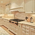 Off White Kitchen Cabinets With Contrasting Island