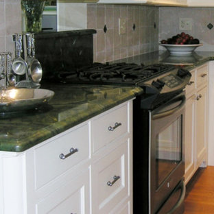 Example of a classic l-shaped eat-in kitchen design in Boston with an undermount sink, beaded inset cabinets, white cabinets, granite countertops, white backsplash, stone tile backsplash and stainless steel appliances