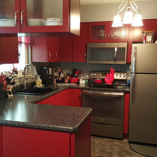 Photo of a small contemporary u-shaped eat-in kitchen in Other with a single-bowl sink, flat-panel cabinets, red cabinets, laminate benchtops, grey splashback, metal splashback, stainless steel appliances, vinyl floors and a peninsula.