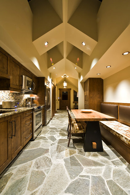Rustic Kitchen by Sticks and Stones Design Group inc.