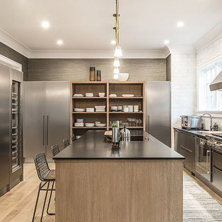 Contemporary enclosed kitchen inspiration - Example of a trendy light wood floor enclosed kitchen design in New York with an undermount sink, open cabinets, white backsplash, stainless steel appliances and an island