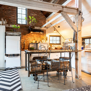 Small shabby-chic style kitchen photos - Kitchen - small shabby-chic style l-shaped beige floor kitchen idea in Other with wood countertops, brick backsplash, a farmhouse sink, shaker cabinets, white cabinets, brown backsplash, white appliances, an island and brown countertops