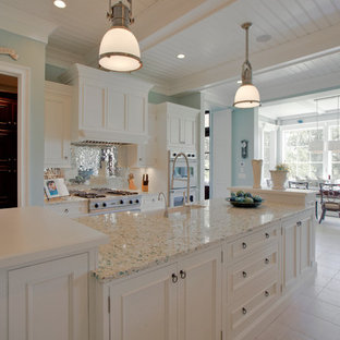 This is an example of a mid-sized traditional single-wall eat-in kitchen in Charleston with a farmhouse sink, recessed-panel cabinets, white cabinets, recycled glass benchtops, stainless steel appliances, metallic splashback, mirror splashback and ceramic floors.