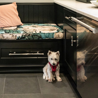 Inspiration for a small transitional galley separate kitchen in Philadelphia with a farmhouse sink, shaker cabinets, green cabinets, quartz benchtops, stainless steel appliances, slate floors and white benchtop.