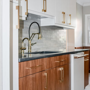 Medium sized contemporary galley kitchen pantry in DC Metro with a submerged sink, flat-panel cabinets, medium wood cabinets, composite countertops, grey splashback, stone tiled splashback, white appliances, porcelain flooring, no island, white floors and grey worktops.