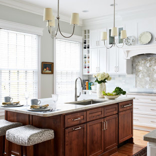 Large traditional enclosed kitchen remodeling - Inspiration for a large timeless l-shaped beige floor enclosed kitchen remodel in DC Metro with an undermount sink, recessed-panel cabinets, white cabinets, gray backsplash, an island and white countertops