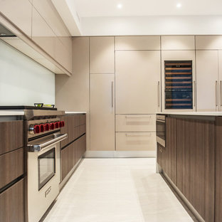 Inspiration for a mid-sized modern l-shaped open plan kitchen in Phoenix with an undermount sink, flat-panel cabinets, medium wood cabinets, marble benchtops, white splashback, glass sheet splashback, panelled appliances, marble floors, multiple islands, white floor and white benchtop.
