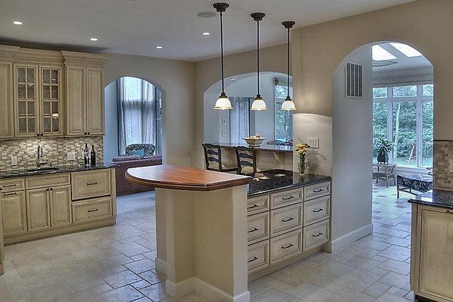 Transitional Kitchen by AV Architects + Builders