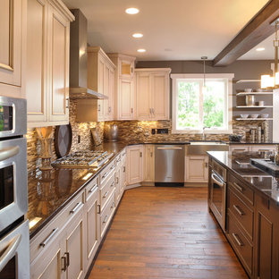 Design ideas for a traditional kitchen in Columbus with stainless steel appliances, a farmhouse sink, recessed-panel cabinets, beige cabinets, brown splashback and matchstick tile splashback.