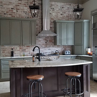 Inspiration for a mid-sized industrial l-shaped eat-in kitchen in Houston with an undermount sink, recessed-panel cabinets, green cabinets, granite benchtops, red splashback, brick splashback, stainless steel appliances, ceramic floors, with island and beige floor.