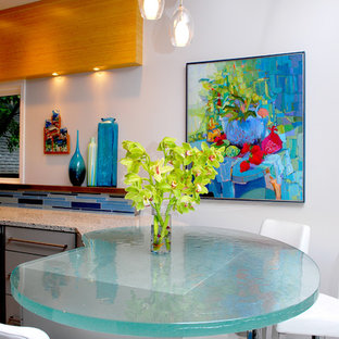 Contemporary kitchen remodeling - Inspiration for a contemporary kitchen remodel in Austin with glass countertops and turquoise countertops