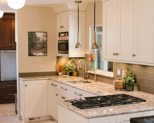 Example Of A Mid Sized Trendy U Shaped Ceramic Floor Open Concept Kitchen  Design