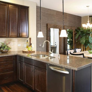 Inspiration for a small modern u-shaped open plan kitchen in San Francisco with an integrated sink, shaker cabinets, dark wood cabinets, granite benchtops, metallic splashback, metal splashback, stainless steel appliances, ceramic floors and with island.