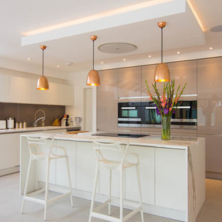 Inspiration for a medium sized contemporary l-shaped kitchen in London with a submerged sink, flat-panel cabinets, white cabinets and an island.