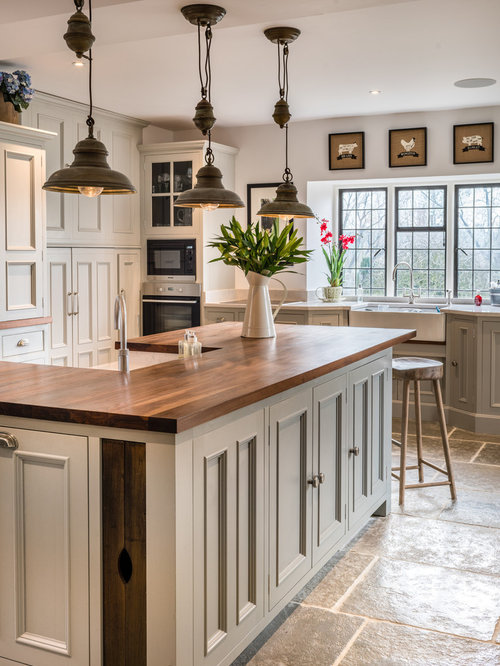 example of a country kitchen design in east midlands with a farmhouse sink beaded inset