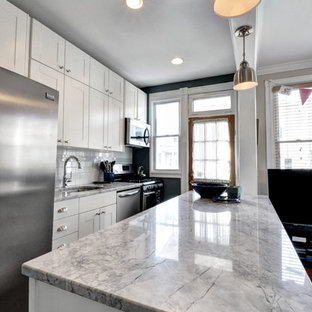 Design ideas for a mid-sized transitional galley eat-in kitchen in DC Metro with an undermount sink, shaker cabinets, white cabinets, quartzite benchtops, white splashback, subway tile splashback, stainless steel appliances, porcelain floors and with island.