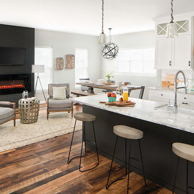 Huge transitional galley medium tone wood floor and brown floor eat-in kitchen photo in Columbus with a farmhouse sink, shaker cabinets, white cabinets, quartz countertops, white backsplash, ceramic backsplash, stainless steel appliances and an island