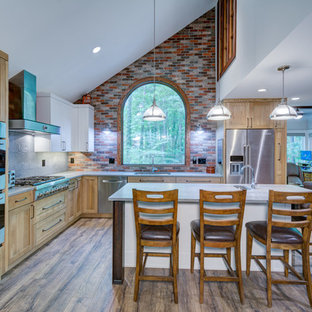 Transitional kitchen inspiration - Kitchen - transitional l-shaped brown floor kitchen idea in Atlanta with an undermount sink, shaker cabinets, light wood cabinets, red backsplash, brick backsplash, stainless steel appliances, an island and gray countertops