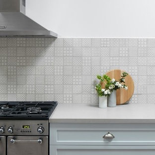 Inspiration for a large industrial l-shaped kitchen pantry in Melbourne with a double-bowl sink, recessed-panel cabinets, blue cabinets, wood benchtops, mosaic tile splashback, stainless steel appliances and with island.