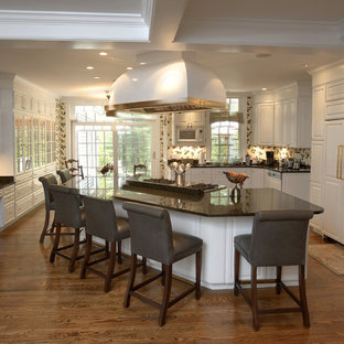 Photo of a traditional kitchen in Denver with raised-panel cabinets and white cabinets.
