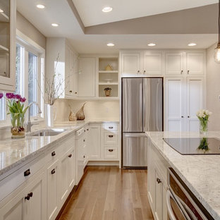 Transitional kitchen appliance - Kitchen - transitional u-shaped kitchen idea in Seattle with an undermount sink, shaker cabinets, white cabinets, stainless steel appliances and an island