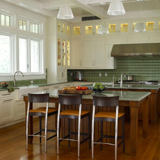 Traditional l-shaped kitchen in Baltimore with a farmhouse sink, stainless steel appliances, green splashback, recessed-panel cabinets, beige cabinets and green benchtop.