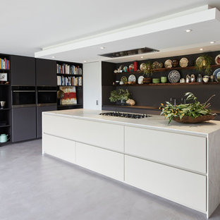 Design ideas for a large eclectic l-shaped open plan kitchen in London with flat-panel cabinets, quartzite benchtops, concrete floors, with island, grey floor, beige benchtop and grey cabinets.