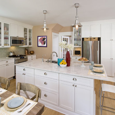 Open concept kitchen - mid-sized contemporary light wood floor open concept kitchen idea in New York with glass-front cabinets, stainless steel appliances, an undermount sink, white cabinets, marble countertops, ceramic backsplash, two islands and green backsplash