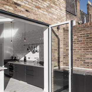 This is an example of a contemporary kitchen in London.