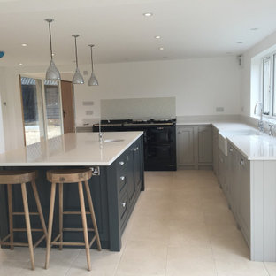 Open plan kitchen with grey handmade cabinets and large blue island