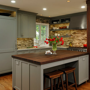 Large transitional kitchen designs - Inspiration for a large transitional l-shaped medium tone wood floor kitchen remodel in DC Metro with shaker cabinets, gray cabinets, ceramic backsplash, paneled appliances, an island, brown backsplash, an undermount sink and wood countertops