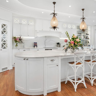 Inspiration for a large beach style kitchen pantry in Sydney with shaker cabinets, white cabinets, marble benchtops, medium hardwood floors, with island, grey benchtop, grey splashback, marble splashback and stainless steel appliances.