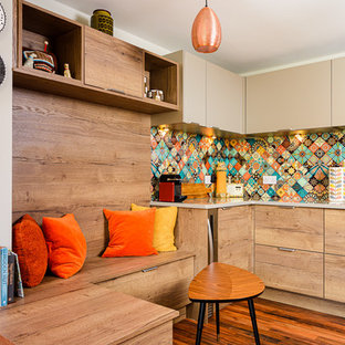 This is an example of a small midcentury galley eat-in kitchen in Other with an undermount sink, flat-panel cabinets, quartzite benchtops, multi-coloured splashback, glass sheet splashback, black appliances, no island and grey benchtop.