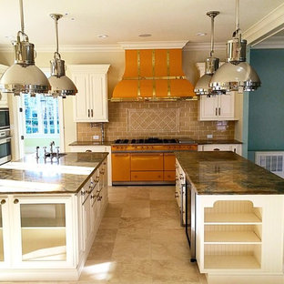 Photo of a contemporary kitchen/diner in Dallas with raised-panel cabinets, white cabinets, granite worktops, beige splashback, ceramic splashback, cement flooring, multiple islands, beige floors and brown worktops.