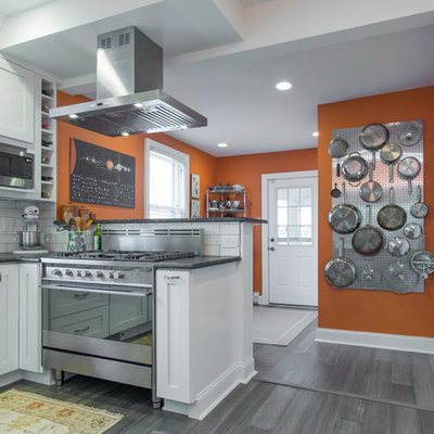 Inspiration for a small modern u-shaped vinyl floor and gray floor enclosed kitchen remodel in Philadelphia with shaker cabinets, white cabinets, granite countertops, white backsplash, ceramic backsplash, stainless steel appliances, no island, gray countertops and a double-bowl sink