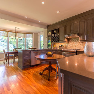 Large contemporary l-shaped eat-in kitchen in Toronto with raised-panel cabinets, green cabinets, multi-coloured splashback, mosaic tile splashback, bamboo floors and brown floor.