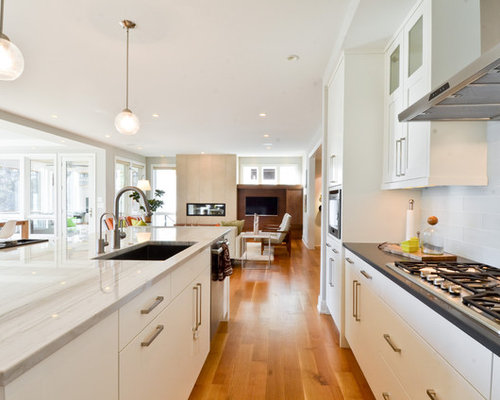 Inspiration For A Contemporary Open Concept Kitchen Remodel In Minneapolis  With Flat Panel Cabinets,