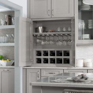 Transitional kitchen ideas - Inspiration for a transitional kitchen remodel in DC Metro with shaker cabinets, gray cabinets, quartz countertops, white backsplash and an island