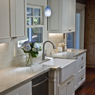 Kitchen - traditional kitchen idea in San Francisco with subway tile backsplash and a farmhouse sink
