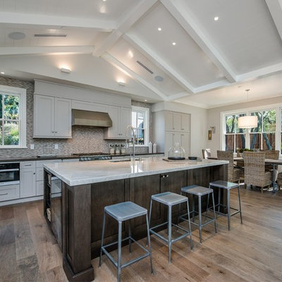 Eat-in kitchen - large cottage l-shaped light wood floor and beige floor eat-in kitchen idea in San Francisco with an undermount sink, shaker cabinets, gray cabinets, multicolored backsplash, stainless steel appliances, an island, quartzite countertops and matchstick tile backsplash