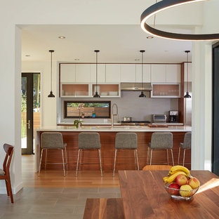 Modern kitchen inspiration - Inspiration for a modern medium tone wood floor and brown floor kitchen remodel in San Francisco