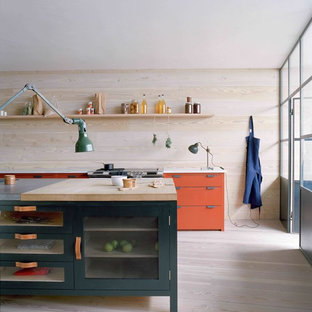 Inspiration for a scandinavian kitchen in London with orange cabinets.