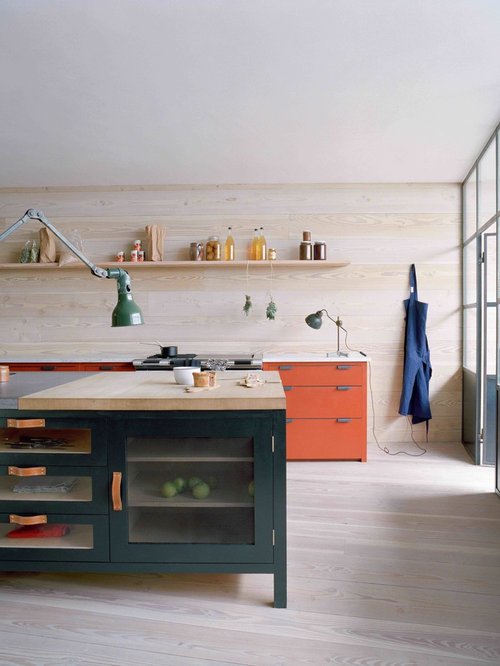 Scandinavian kitchen ideas - Inspiration for a scandinavian kitchen remodel  in London with orange cabinets