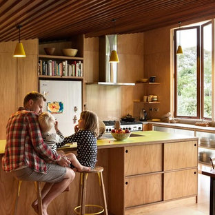 Contemporary l-shaped eat-in kitchen in Auckland with open cabinets, medium wood cabinets, stainless steel appliances, medium hardwood floors, with island and yellow benchtop.