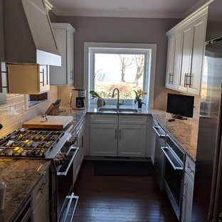 Design ideas for a small transitional galley eat-in kitchen in New York with a double-bowl sink, shaker cabinets, white cabinets, solid surface benchtops, white splashback, ceramic splashback, stainless steel appliances, dark hardwood floors, no island, multi-coloured benchtop and brown floor.